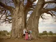Family picture by a baobab tree in Zimbabwe